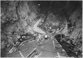 """Operations at inlet portal of diversion tunnel No. 2. Invert concrete and trashrack transition base are seen."" - NARA - 293643.tif"