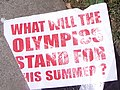 """What will the Olympics stand for this summer?"" sign, Olympics torch protest (2418175698) (cropped).jpg"
