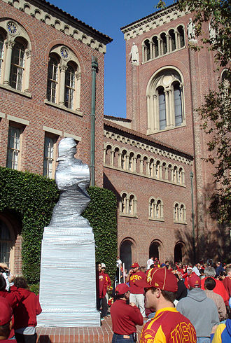 "1997 USC Trojans football team - ""Tommy Trojan"" is wrapped in duct tape during the week preceding the game to protect it from vandalism."