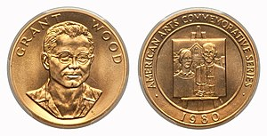 A gold medallion depicting the bust of a man, as well as a painting