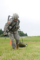 1st Lt. Jeremy Gilbert tackles the stress shoot event (7645780154).jpg