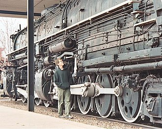 "Two Harbors, Minnesota - A tourist views Duluth, Missabe & Iron Range Railway 2-8-8-4 ""Yellowstone"" preserved at Two Harbors (2004)."