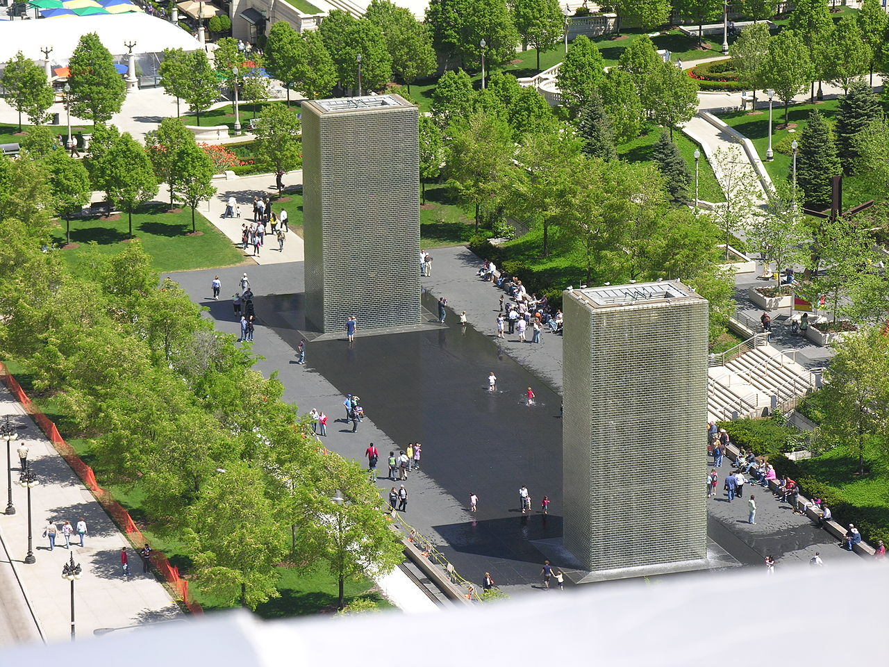 View of the fountain shows glass brick towers from rooftop nearby.