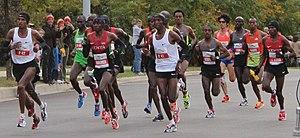 2012 Chicago Marathon - The large leading pack of elite men at mile six