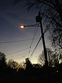 2014-12-26 16 56 05 Sodium vapor street light on an older support just after turning on for the night along Meridan Avenue in Ewing, New Jersey.JPG