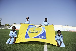 FIFA Fair Play Award - Ball boys in Somalia hold a FIFA Fair Play banner.