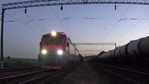 Файл:2ES5-005 with freight train.webm