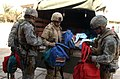 301st PSYOP Company, USAR, Calif., and 3-7 Cavalry, Fort Stewart, Ga., soldiers give away school supplies in Safia Bint Abdul Mutaleb School in 2007.JPG