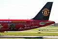 9M-AFC A320-214 Air Asia 4 (MUFC logojet left side aft) MAN 05APR06 (5821837845).jpg