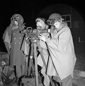 Christian Fraser-Tytler - ATS personnel operating a rangefinder at a 3.7-inch AA gun site firing against V-1 flying bombs, 21 July 1944.