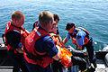 A Canadian coast guardsman, U.S. Coast Guard Seaman Apprentice Anthony Kelley, Petty Officer 3rd Class Brian Abel and Petty Officer 2nd Class Shawn Wilkinson transfer Canadian coast guardsman Liam Jeffrey to 090825-G-JG957-117.jpg