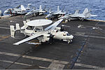 A U.S. Navy E-2C Hawkeye aircraft assigned to Airborne Early Warning Squadron (VAW) 115 lands aboard the aircraft carrier USS Nimitz (CVN 68) in the South China Sea Nov. 22, 2013 131122-N-TW634-280.jpg