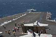 A U.S. Navy F-A-18C Hornet aircraft assigned to Strike Fighter Squadron (VFA) 146 launches from the aircraft carrier USS Nimitz (CVN 68) in the Pacific Ocean April 8, 2013 130408-N-LP801-313