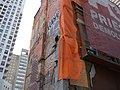 A small building left during construction, Yonge and Bloor, 2018 01 31 -c (39122346255).jpg