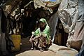 A woman sits outside of her home in Mogadishu, Somalia, during a visit to an IDP camp by the Special Representative of the Secretary-General on Sexual Violence in Conflict on April 2. The SRSG, Zainab (8620538859).jpg