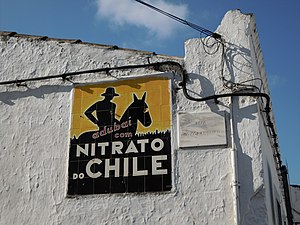 Sodium nitrate - Advertisement for sodium nitrate fertilizer from Chile on a wall of a village in the Algarve area of Portugal