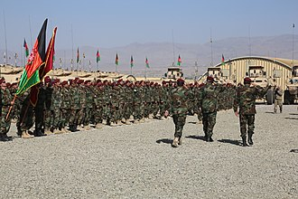 Paktia Province - Afghan National Army Brig. Gen. Abdul Karim, the commando commander of the 1st Special Operations Brigade, inspects a formation during the brigade's opening ceremony at Forward Operating Base Thunder (August 2013)
