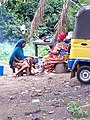 African women cooking food for sale.jpg