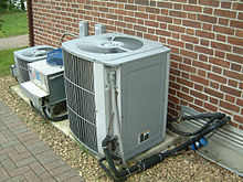 An external installation of central air conditioning.