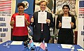 Ambassador Joseph Cella shows the signed grant with the Women Entrepreneurs Business Council.jpg