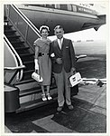 An unidentified couple stand on the steps to an aircraft (13244363504).jpg