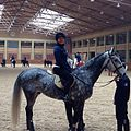 Andrea, first American to ride a horse at the Mirim Riding Club in Pyongyang. Horse's name is Sanmae, 8 years old. She was a beauty. (11263838695).jpg