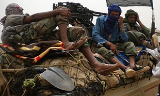Jihad - Rebels from the militant Islamist sect Ansar Dine in Mali on a truck with a DShK machine gun