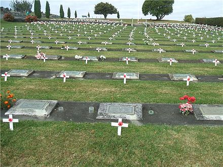 Each year on ANZAC Day in Te Awamutu, New Zealand the graves of War Veterans are decorated Anzac Day 1.jpg