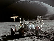 Astronaut works on the Moon at the lunar rover