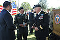 Army Brig. Gen. Orlando Salinas, right, deputy commanding general of U.S. Army South, visits with Retired Sgt. Carlos Garza and other guests, at the University of Texas, after the Veterans Day ceremony in 121108-A-ZZ999-356.jpg