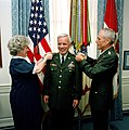 Army CHIEF of STAFF General John A. Wickham Jr. and Mrs. Ann Rockwell each pin a third star on the shoulders of Lieutenant General James M. Rockwell during his promotion ceremony at the Pentagon.jpg