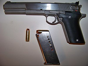 AMT AutoMag V - AMT Automag V with factory 5-round magazine and .50 Action Express Cartridge.