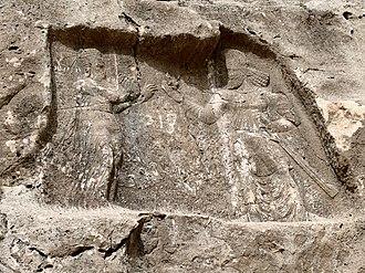 Barm-e Delak - Sasanian king Bahram II offering a lotus flower to his wife