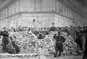 History of socialism - Barricades Boulevard Voltaire, Paris during the uprising known as the Paris Commune