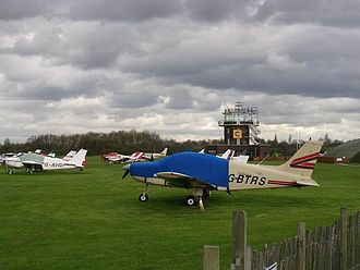 City Airport & Heliport - An aircraft parking area at City Airport in front of the control tower