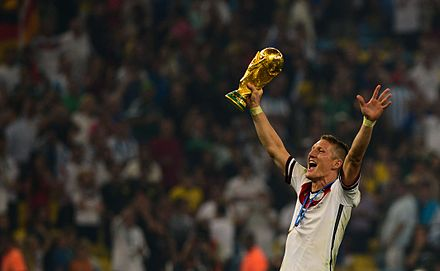 Schweinsteiger celebrates with the World Cup trophy after winning the 2014 FIFA World Cup Final. Bastian Schweinsteiger celebrates at the 2014 FIFA World Cup.jpg
