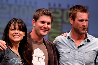 Michelle Rodriguez - From left to right, Rodriguez, Jonathan Liebesman and Aaron Eckhart at the 2010 San Diego Comic-Con International