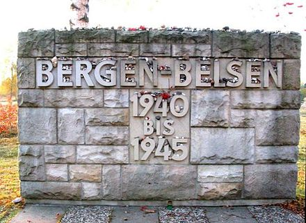 Memorial stone at the entrance to the historical camp area Bergen-belsen.jpg