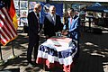 Bernd Wiegand, Reiner Haseloff and Timothy Eydelnant cut the Independence Day Cake.jpg