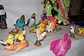 Birds in a Golu display over Hindu Navaratri festival Kolu dolls.jpg