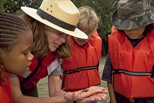 Heritage interpretation - Biscayne National Park ranger shows a hermit crab to children