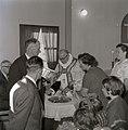 Bishop Wisløff baptizes the child of Edit and Amandus Karlsen.jpg