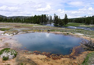 Protected area - Black Opal Spring in Yellowstone National Park in the United States. Yellowstone, the world's second official protected area (after Mongolia's Bogd Khan Mountain), was declared a protected area in 1872, and it encompasses areas which are classified as both a National Park (Category II) and a Habitat Management Area (Category IV).