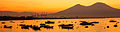 Boats and Mount Vesuvius at sunrise (8204145887).jpg