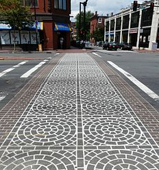 Painted crosswalk with complex multi-colored patterns in Boston