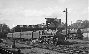 Bournemouth railway station - BR Standard 5MT 4-6-0 No. 73110 approaching the station 10 May 1958. The Locomotive Depot is visible behind the locomotive.