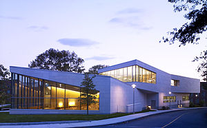 Brandeis University -  Brandeis's admissions building at night.
