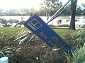 Brisbane River and damaged Jindalee Boat Ramp Park sign.jpg
