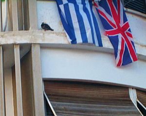 Greece–United Kingdom relations - Greek and British flags waving from a window in Athens