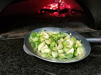 Brussels sprout - Brussels sprouts prepared for cooking in a wood-fired pizza oven